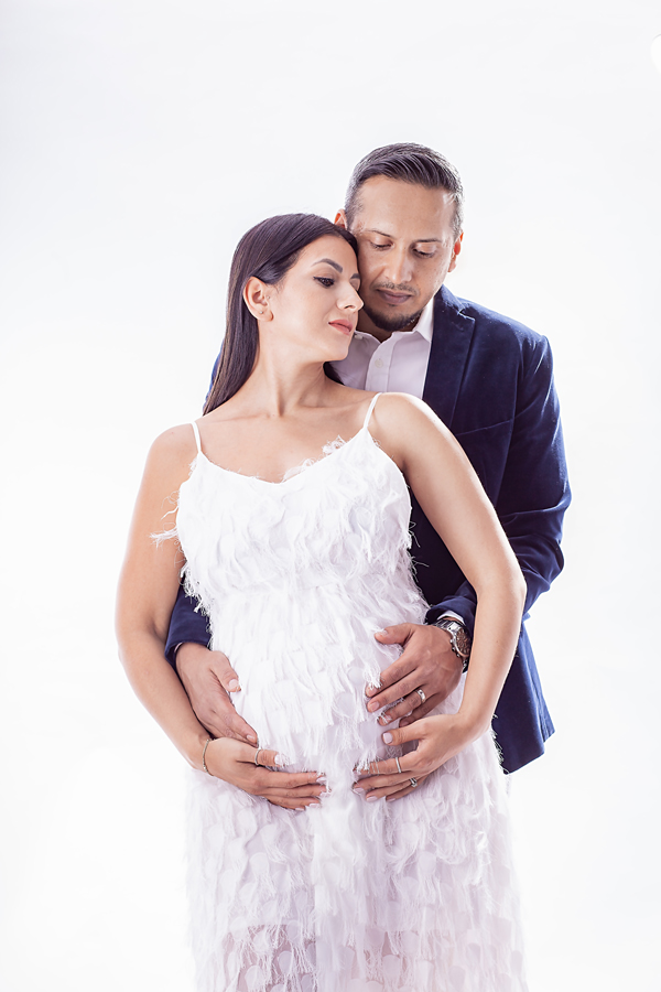 Image of pregnant mother and daughter in white from maternity and family photographer based in Buckinghamshire and Hertfordshire in South East, UK